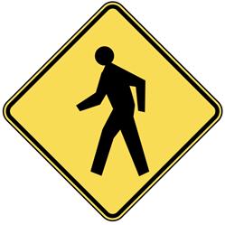 man walking street sign